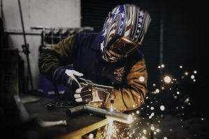 Man using Welding Supplies and safety equipment